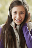 Teenage Girl Wearing Headphones And Listening To Music Wearing W — Stock Photo