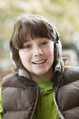 Boy Wearing Headphones And Listening To Music Wearing Winter Clo — Stock Photo