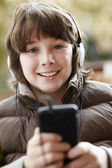 Boy Wearing Headphones And Listening To Music On Smartphone Wear — Stock Photo