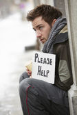 Homeless Young Man Begging In Street — Stock Photo