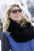 Young Woman On Ski Holiday In Mountains — Stock Photo