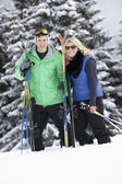 Young Couple On Ski Holiday In Mountains — Stock Photo
