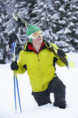 Young Man On Ski Holiday In Mountains — Stock Photo
