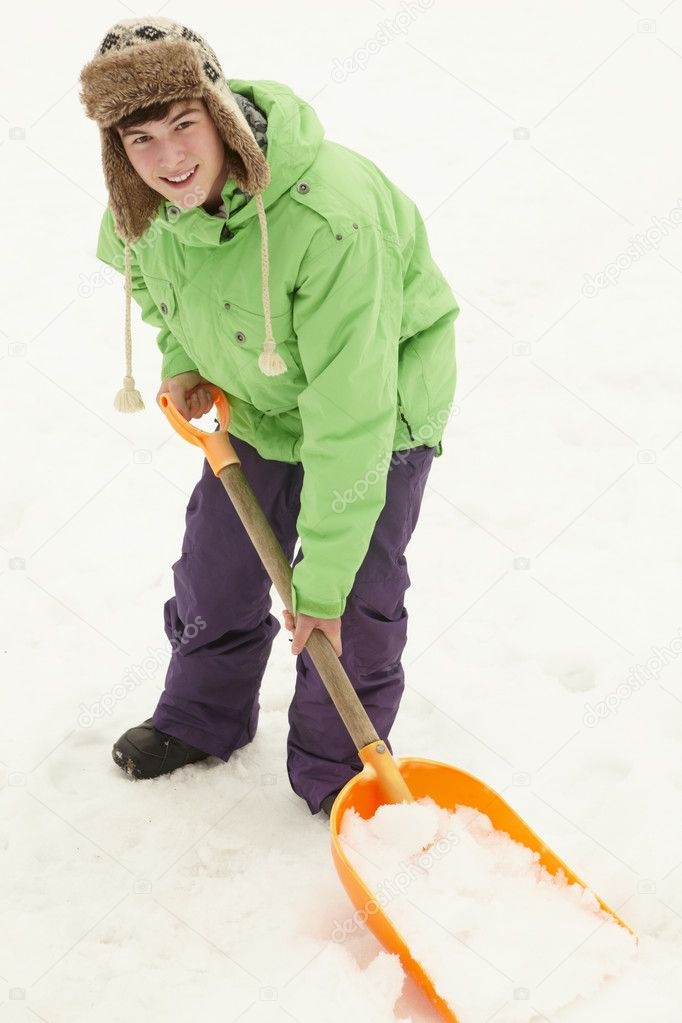 Teenage Boy Shovelling Snow From Path — Stock Photo #11891159