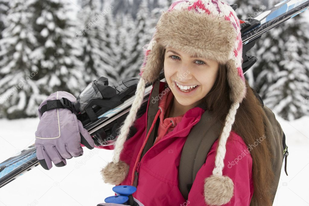 Teenage Girl On Ski Holiday In Mountains — Stock Photo #11891868