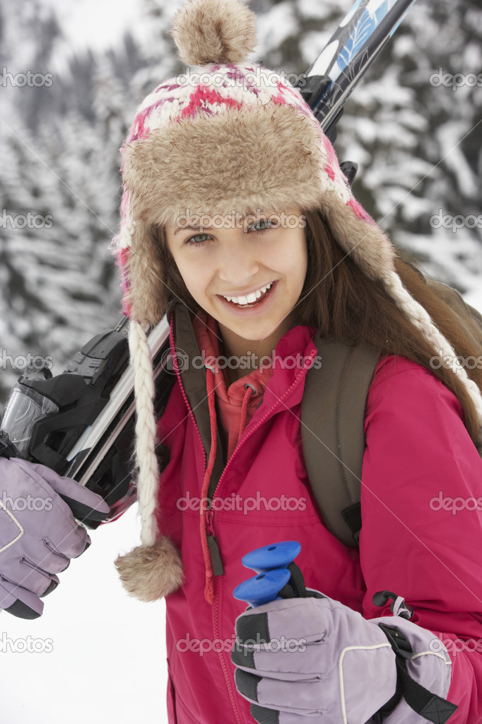 Teenage Girl On Ski Holiday In Mountains — Stock Photo #11891869