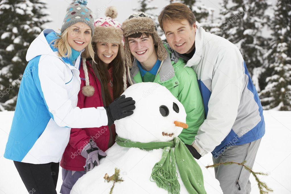 Teenage Family Building Snowman On Ski Holiday In Mountains — Foto Stock #11891965