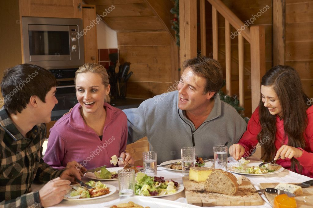 Teenage Family Enjoying Meal In Alpine Chalet Together — Stock Photo #11892081