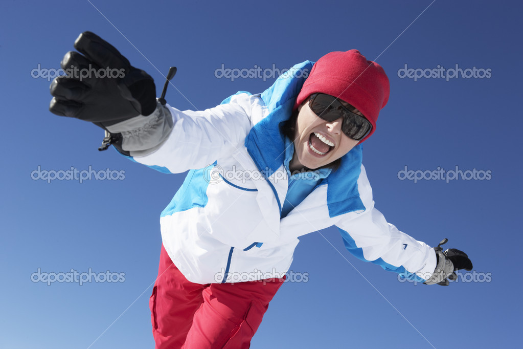 Woman Having Fun On Ski Holiday In Mountains — Stock Photo #11892523