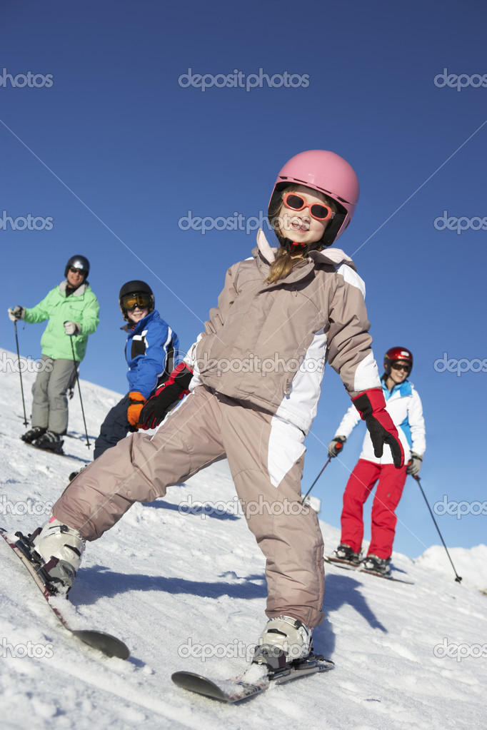 Family On Ski Holiday In Mountains — Stock Photo #11892641
