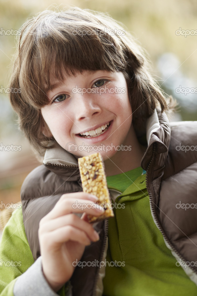 Boy Eating Healthy Snack Bar Wearing Winter Clothes — Stock Photo #11893719