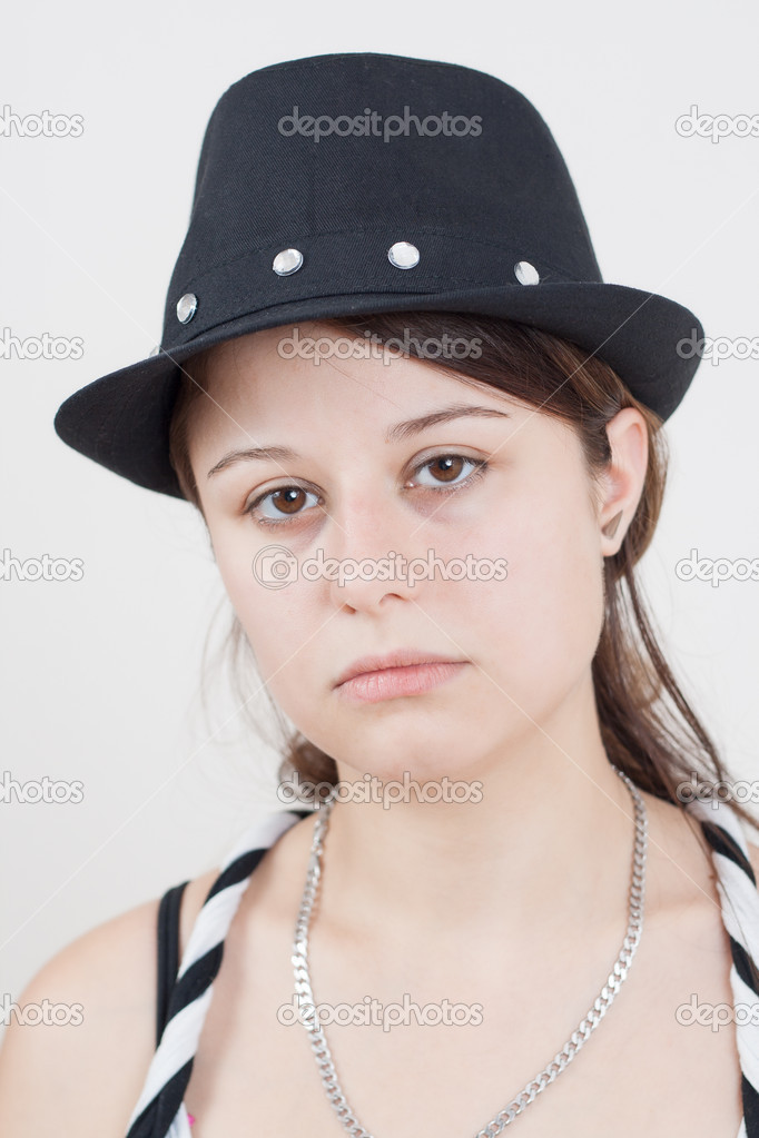 Portrait of young brunette girl wearing a black hat — Stock Photo #12102999