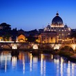 Sant' Angelo Bridge and Basilica of St. Peter in Rome, Italy - Stock Photo