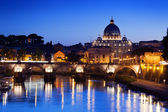 Sant' Angelo Bridge and Basilica of St. Peter in Rome, Italy — Stock Photo