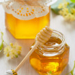 Two jars of linden honey - Stock Photo