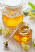 Two jars of linden honey — Stock Photo