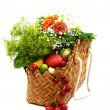 Summer fruits, vegetables and flowers in a basket - Stock Photo