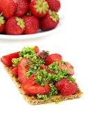 Strawberry brusketa with parsley pesto. — Stock Photo