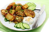 Fritters zucchini, potatoes and sour cream sauce. — Stock Photo