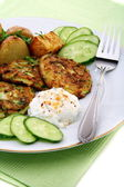 Zucchini fritters,garnish and sour cream sauce. — Stock Photo