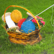 Flower basket with thread, needle, balls for knitting — Stock Photo