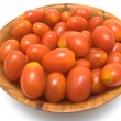 Plum tomatoes in wooden dish - Stock Photo