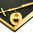Golden Cross and Apple on Bible — Stock Photo