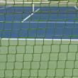 Green outdoor tennis court net — Stock Photo