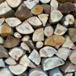 Chopped firewood logs in a pile as background — Stock Photo