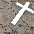 Cross on dry ground — Stock Photo