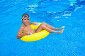 Taking sunbath in the pool — Stock Photo