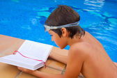 Kid reading near pool — Stock Photo