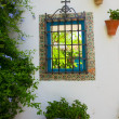 Window in andalusian patio — Stock Photo