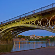 Triana Bridge at night, Seville, Spain - Stock Photo