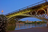 Triana Bridge at night, Seville, Spain — Stock Photo