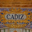 Cadiz sign over a mosaic wall — Stock Photo