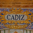 Stock Photo: Cadiz sign over mosaic wall