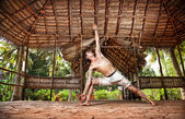 Yoga man in Indian shala — Stock Photo