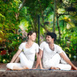 Couple yoga matsyendrasana pose — Stock Photo #11060128