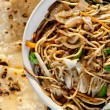 Stock Photo: Veg noodles and butter naan
