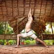 Yoga warrior in Indian shala — Stock Photo