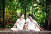 Couple yoga matsyendrasana pose — Stock Photo