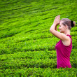 Stock Photo: Praying womin teplantations