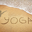 Yoga on the sand - Stock Photo