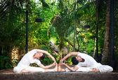 Couple yoga in the garden — Stock Photo