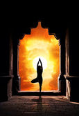 Yoga silhouette in temple — Stock Photo