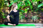 Yoga in the garden — Stock Photo
