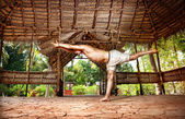 Yoga warrior in Indian shala — Stock Photo