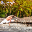 Yoga on the beach — Stock Photo #11621021