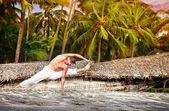 Yoga on the beach — Stock Photo